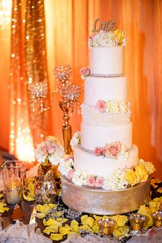 Wedding cake wedding of oliver and hanna in yuma arizona the 5 tier wedding cake with pink and yellow roses the word love as a cake junglespirit Gallery
