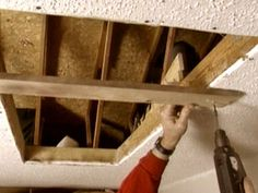 Install attic stairs and lay plywood in the attic http://www.diynetwork.com/how-to/how-to-create-attic-storage/index.html