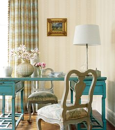 Interesting idea for a desk! Could be recreated by adhering two antique-store end tables with a longer piece of wood.
