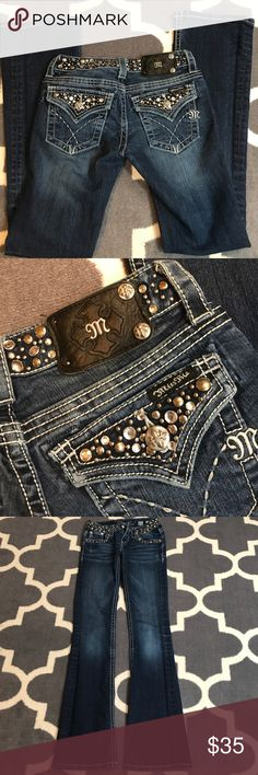 Miss Me mega Studded jeans 24 x 31.5 Studded to the max! Blinged out! These are a great pair of Miss Me jeans gently pre owned. No rips or stains. No damage to ends. Zipper flows smoothly. Front rise 6.5 inches. Bundling is fun; check out my other items! No price talk in comments. No trades or holds. NO SPAM. A432 Miss Me Jeans Boot Cut