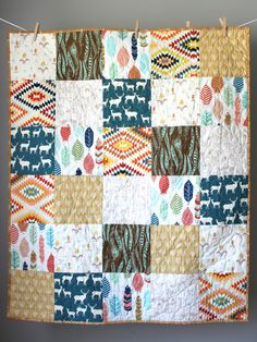 This quilt is completed and ready to ship to you! This modern gender neutral quilt is made using a custom mix of rustic woodland fabrics and modern