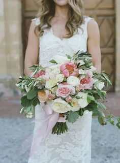 Pink peonies add softness and romance to this overflowing bridal bouquet. Fleurs du Soleil. Colleen Riley Photography.