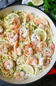 Shrimp pasta in a cast iron red dish with lemon slices and fresh parsley on top. Frozen Cooked Shrimp, Frozen Shrimp Recipes, Cooked Shrimp Recipes, Seafood Pasta Recipes, Shrimp Recipes For Dinner, Seafood Dinner, Fish Recipes, Cooking Recipes, Healthy Recipes