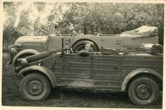 A VW Type 82 Kubelwagen next to a Kfz15 Horch staff car