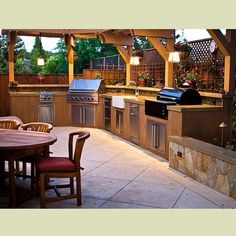 An abundance of pendant lights allow the cooks to see what they are doing in this gracious outdoor kitchen.
