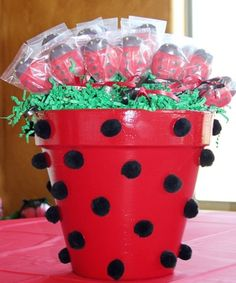 I like this idea, but I'd rather paint black polka dots rather than the pom poms.