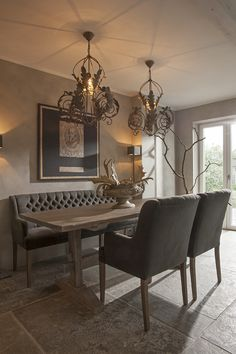 warm dining space design chocolate brown banquette dining french inspired lighting