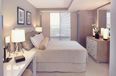 beautiful grey bedroom with high gloss white contemporary furniture and lovely lighting