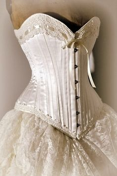 Unsure if this is a bustier or a corset. A corset changes the female shape- a bustier molds to it - and does not push the inner organs around.