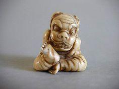 images of shi shi masks   Ivory Netsuke of a boy wearing Shishimai