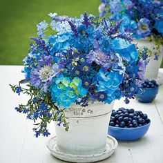 Embrace the Blues | To create this arrangement, we used billowy hydrangeas, plumbagos, cornflowers, and scabiosas for visual heft. We then filled in with salvias, cinerarias, and 'Techno Heat' lobelias to add texture. The result? A casual centerpiece with a vibrant blue palette that makes for a tranquil focal point.