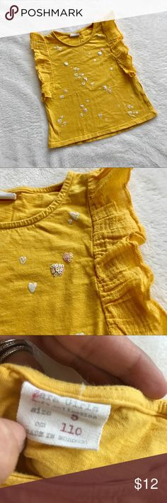 Zara Kids Butterfly Top Beautiful, sunflower yellow Zara top with butterfly sleeves and a few sequins for fun!   Excellent used condition. Only worn a couple times. No visible stains or defects.   Smoke-free, pet-free home. Only washed with fragrance and dye-free detergent.   Bundle with other cute items from my closet for a discount! I have a few great girls items (size 3, 4 & 5). Zara Shirts & Tops Tees - Short Sleeve