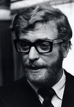 Michael Caine, an originator of the don't-mess-with-four eyes look.