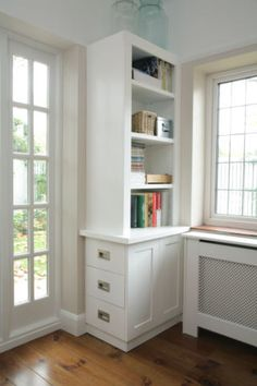 Instead of double doors on the base they used side drawers to fit since front was obstructed by radiator.