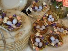 Easter morning table set for brunch.  Robin's eggs (candy) in birds nests.