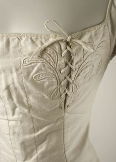 c.1820-30 Cotton Nursing Corset  Met     1999.216.5  Close up of the lacing on ONE side. looks like a later alteration to me.
