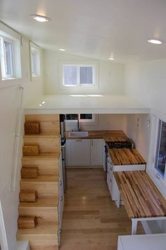 There's some nice ideas to like in this modern and functional design, which allows for a larger kitchen and even a bathtub to be included in the mix. The Chickadee is available as a fully finished turnkey for USD $55,300. For more information, google Brevard Tiny Homes.