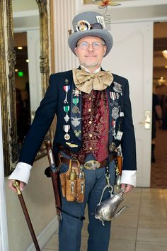 Highly Decorated Steampunk (man with steampunk military medals, awards, & ribbons) - For costume tutorials, clothing guide, fashion inspiration photo gallery, calendar of Steampunk events, & more, visit SteampunkFashionGuide.com