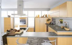 Extractor Hoods Above Laminate Countertop And Silver Bar Stools Also Outdoor Tile In Stylish Kitchens Ideas