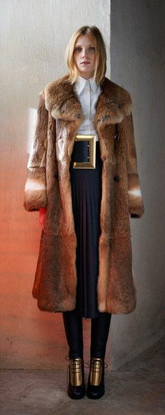 Floor-length furs and gold embellishments at Céline
