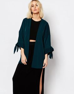 Weekday Drapey Kimono With Tie Sleeve Detail.  Product Brand Info Kimono by Weekday Woven fabric Open front  Dropped shoulder seams Tied sleeve detail Oversized fit - falls generously over the body Machine wash 96% Polyester, 4% Elastane