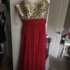 Red Prom Dress!! Beautiful, long Red strapless prom dress / gown with golden jewels on the top. Only worn once great condition just needs to be steamed to get a few wrinkles out! Great find for great price!!  Note: I am 5'4 and wore it with heels and it was perfect in length. Dresses Prom