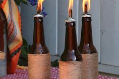 Instead of throwing away empty wine and beer bottles, make kick-ass tiki torches that will wow everyone. | Reuse Old Wine Bottles As Incredibly Cute Tiki Torches