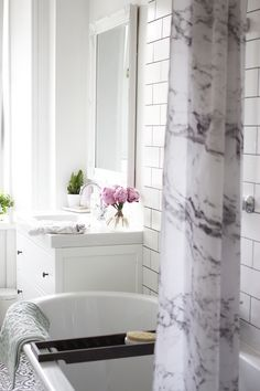 Marble Curtain!! Kate La Vie's Bathroom http://curatedinterior.com/styled-space-kate-la-vie/