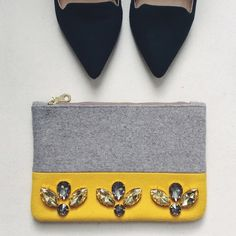 """Anthropologie Gem Clutch Beautiful Gray & Yellow Pouch.                                   • WOOL. with polyester lining.                                    • plastic + glass jewel detail.                                        • dimensions : 6"""" height / 9"""" width.                              • this is a small pouch, I however used it as a small clutch because it's too cute lol!                              • used 1-2 times, in perfect condition! Anthropologie Bags Clutches & Wristlets"""