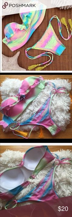 """Cotton candy bikini Brand new, super feminine  and sexy ruffle bikini. Second pic is actual item. Top is strapless . Bottom is low waist, tie waist, and Brazilian cut. Yellow tassels attached. Material is 100% polyester. NO TRADES. size large. Measurements shown in last column with cup size """"CD"""".. BRAND FOR EXPOSURE Missguided Swim Bikinis"""