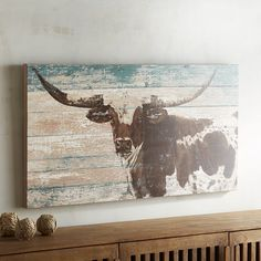 Against a background evoking weathered, reclaimed wood, a majestic longhorn has been painted in authentic brown and white. At once nostalgic and ruggedly outdoorsy, this is art with two points of view for retreats, studies and dens. Western Bedroom Decor, Western Rooms, Rustic Western Decor, Country Decor, Farmhouse Decor, Western Bathrooms, Western Style, Cow Decor, Cow Skull Decor
