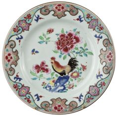 A Chinese export porcelain plate painted in famille rose enamels and decorated with a cockerel. Yongzheng period. China/Asia Decorated in the famille rose palette, with a cockerel on a rock and peonies.