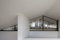 Naoi Architecture and Design Office // Hut in Tsujido ;  The main structure of this house is produced in wood, while the roof is designed to as a simple truss structure with vertical struts in steel. In order to maintain the openness of the interior space with the sloped ceiling, the roof truss is exposed, but the thin steel frames of the trusses remain slightly hidden as to harmonize with the rest of the interior space.