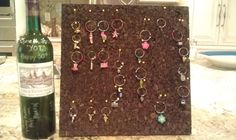 Wine Glass Charms displayed on cork board for a 50th Birthday Party