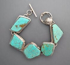 A beautiful sterling silver bracelet with five natural and beautiful natural turquoise cabochons from the #8 mine in northeast Nevada. Beautiful large