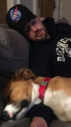 Chris Evans, sleeping beside his dog in a NASA hat.....too many levels of sexy