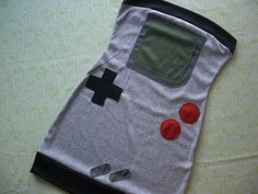 Gameboy: Geek out with this gameboy costume.  What you need to do: Wear a gray tube dress. Cut out shapes from cloth to make the screen and buttons.  Source: Etsy user sewoeno