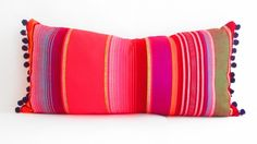 Tribal red throw pillows in bright apple red with accent colors of purple, green, orange, hot pink, black and white.
