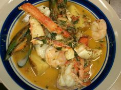Bouillabaisse - Our version includes Lobster, Crab, Mussels, Shrimp, Fish of the Day in a delicious fresh Basil, Roasted Red Pepper Sauce, Harry's Hideaway, Cornville, Az.