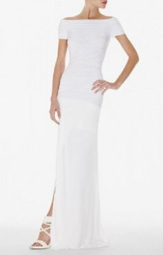 $238.00 Embody modern-classic elegance in this figure-hugging, floor-sweeping and totally indulgent dress.  Off the shoulder neckline.Short sleeves.Full-length silhouette.Crisscross detail at bodice.Dropped waist.Front slit.Center back zipper with hook-and-eye closure.Rayon, Nylon, Spandex.Imported