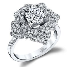 This showstopping white gold ring from Parade's Lyria Bridal collection calls to mind a night-blooming flower in the full light of the moon for a look like no other with your choice of center stone…MoreMore