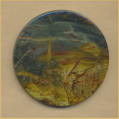 MOR443cc Morrisonite Jasper Cabochon  features a beautiful abstract landscape of blue, green, red, gold, and tan jasper.  58mm diameter