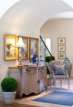 love the barrel hallway, pretty sideboard, not to mention the fabulous use of blue and white throughout this eclectic space