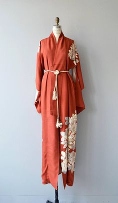 Vintage silk kimono from the 1950s in rich persimmon with cream and grey flowers around the hem and climbing onto the sleeves and shoulder and silk coiled rope belt.  ✂-----Measurements  fits like: free size bust: free waist: free length: 63 brand/maker: n/a condition: excellent ✩ layaway is available for this item  to ensure a good fit, please read the sizing guide: http://www.etsy.com/shop/DearGolden/policy  ✩ visit the shop ✩ http://www.DearGold...