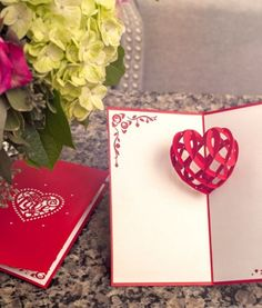 Paper-cut heart pop-up love card.  Perfect Valentine's Day or Anniversary gift.  Intricate embellishments help you say something special with this stunning card.