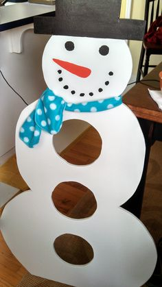 "I found this idea on Pinterest, and expanded upon it!  The ""wooden"" snowman was designed by me, cut out by my co-teacher's dad and then painted and decorated by me.  We used it as a bean bag toss at our school's winter festival.  I made ""snowballs"" out of blue flannel and rice.  It was a BIG hit with all the children!"