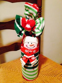 Wine, christmas socks, and a bottle neck decoration make a great exchange gift!