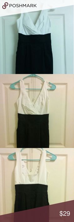 *Reduced* EXPRESS Sleek B&W Dress Size 00 XXS XS 0 Fashionable, sleek and modern dress by Express. Never worn. Detail band to accentuate waist line. V-neck top in clean white and bottom in slimming black (or dark navy) with peek-a-boo slit on the back on the skirt. Inner lining and excellent quality. Size 0 (or XS). Tag shows size 00. *** Make an Offer *** Express Dresses Midi