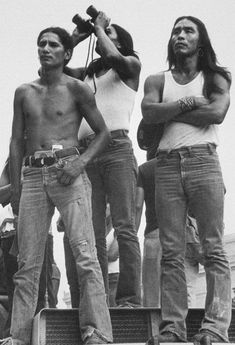 1973. The American Indian Movement occupies Wounded Knee, South Dakota. Leaders Russell Means and Carter Camp, with 200 activists and the Lakota Sioux of the Pine Ridge Reservation occupied the town for 71 days to protest government failures to honor treaties with Native Americans.
