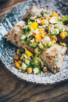 Buckwheat Crepes with Shredded Sauteed Brussels Sprouts, Chickpeas, Roasted Pumpkin, Tahini and Hazelnuts